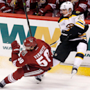 Boston Bruins' Loui Eriksson (21), of Sweden, collides with Arizona Coyotes' Antoine Vermette (50) during the third period of an NHL hockey game Saturday, Dec. 6, 2014, in Glendale, Ariz. The Bruins defeated the Coyotes 5-2 The Associated Press