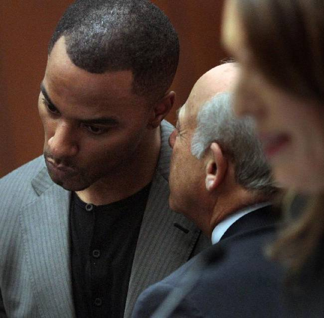 Former NFL safety Darren Sharper, right, huddles with attorney Leonard Levine in Los Angeles Superior Court on Thursday, Feb. 20, 2014, in Los Angeles. Sharper has pleaded not guilty to charges that he drugged and raped two women he met at a West Hollywood night club