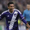 Anderlecht's Andy Najar celebrates after scoring the opening goal of the game during the Group D Champions League match between Anderlecht and Arsenal at Constant Vanden Stock Stadium in Brussels, Belgium, Wednesday Oct. 22, 2014