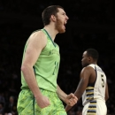 Notre Dame's Garrick Sherman (11) reacts after scoring as Marquette's Junior Cadougan (5) walks by during the second half of an NCAA college basketball game at the Big East Conference tournament, Thursday, March 14, 2013, in New York. Notre Dame won 73-65. (AP Photo/Frank Franklin II)