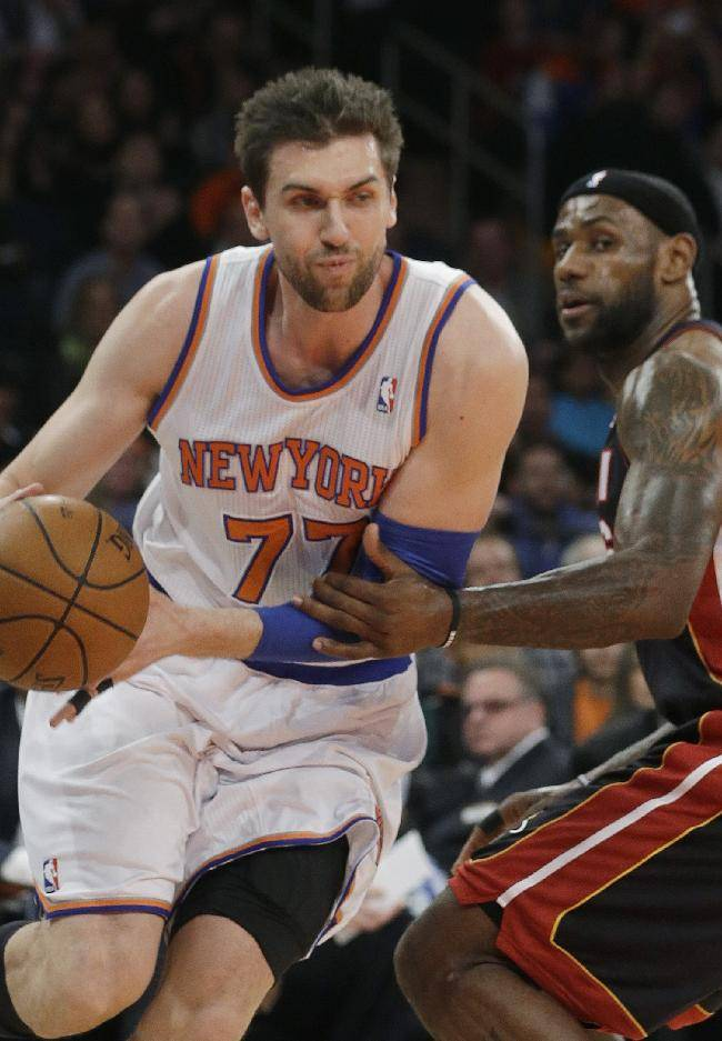New York Knicks' Andrea Bargnani (77) drives past Miami Heat's LeBron James, right, during the first half of an NBA basketball game on Thursday, Jan. 9, 2014, in New York
