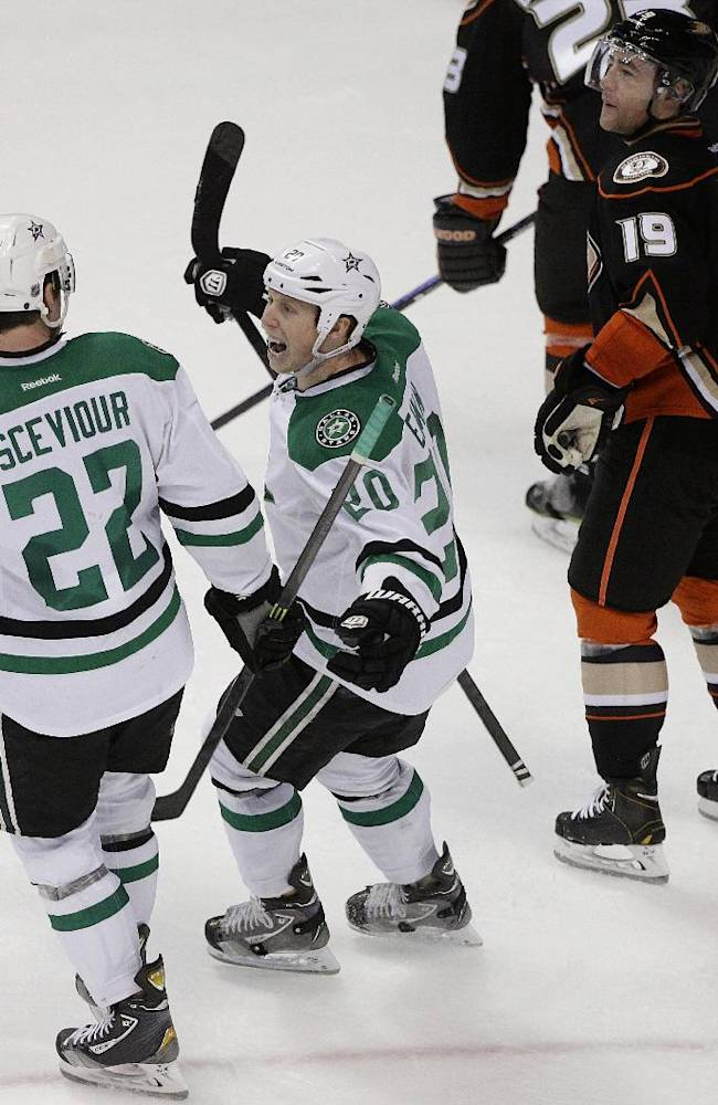 Dallas Stars' Colton Sceviour(22) celebrates his goal with Cody Eakin(20) as they skate past Anaheim Ducks' Stephane Robidas (19) during the second period in Game 1 of the first-round NHL hockey Stanley Cup playoff series on Wednesday, April 16, 2014, in Anaheim, Calif