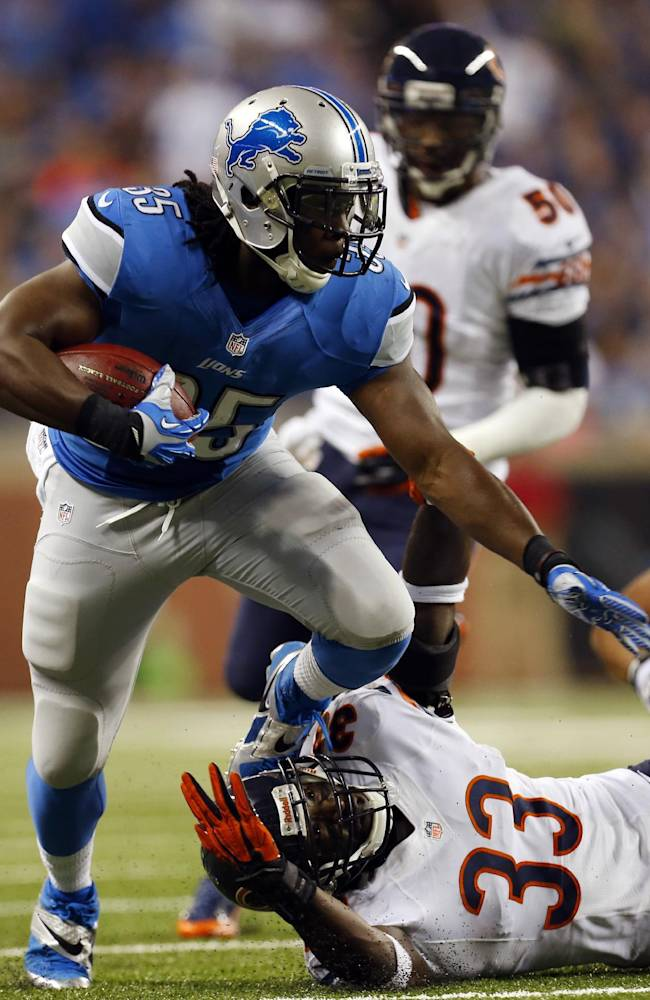 Detroit Lions running back Joique Bell (35) pulls away from Chicago Bears cornerback Charles Tillman (33) during the first quarter of an NFL football game at Ford Field in Detroit, Sunday, Sept. 29, 2013