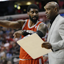 Milwaukee Bucks' O.J. Mayo, left, points as he talks to head coach Larry Drew, right, during the second half of an NBA basketball game against the Philadelphia 76ers, Monday, Feb. 24, 2014, in Philadelphia. The Bucks won 130-110 The Associated Press