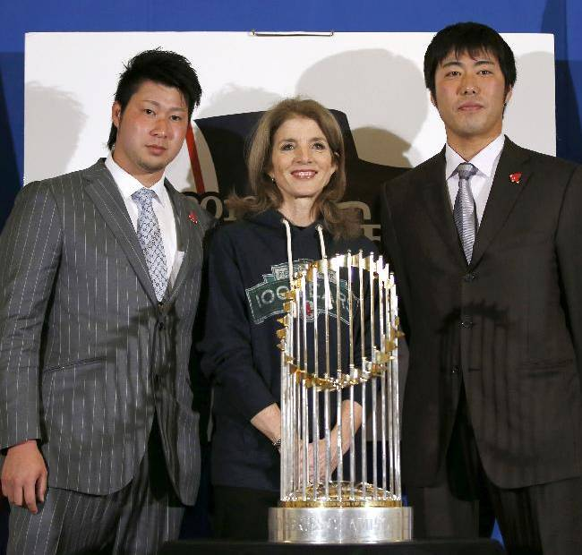 U.S. Ambassador to Japan Caroline Kennedy, center, Boston Red Sox pitchers Junichi Tazawa, left, and Koji Uehara pose for photos with the World Series trophy at the U.S. embassy in Tokyo, Tuesday, Jan. 21, 2014