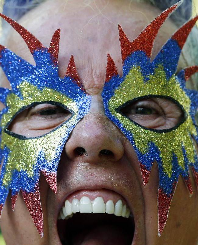 A football supporter cheers before the World Cup quarterfinal soccer match between Brazil and Colombia at the Arena Castelao in Fortaleza, Brazil, Friday, July 4, 2014