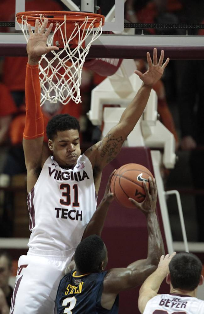 Virginia Tech forward Jarell Eddie (31) defends against West Virginia guard Juwan Staten (3) during the second half of an NCAA college basketball game in Blacksburg, Va., Tuesday, Nov. 12, 2013