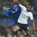 Chelsea's Demba Ba, left, fights for the ball with Tottenham Hotspur's Kyle Naughton during their English Premier League soccer match, at the Stamford Bridge Stadium in London, Saturday March 8, 2014