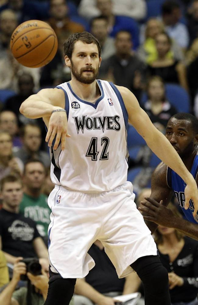 In this photo taken on Friday, Nov. 8, 2103, Minnesota Timberwolves' Kevin Love  passes the ball during an NBA basketball game against the Dallas Mavericks. Love has often been criticized for being more concerned about racking up stats than making his teammates better, but he took that criticism to heart and has taken his game and team to another level this season, averaging a career-high 5.0 assists per game