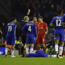 Liverpool's Steven Gerrard, center right, is shown a yellow card during the English League Cup semi-final first leg soccer match between Liverpool and Chelsea at Anfield Stadium, Liverpool, England, Tuesday Jan. 20, 2015