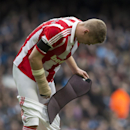 Stoke's Ryan Shawcross replaces a piece of protective equipment during his team's English Premier League soccer match against Manchester City at the Etihad Stadium, Manchester, England, Saturday Feb. 22, 2014