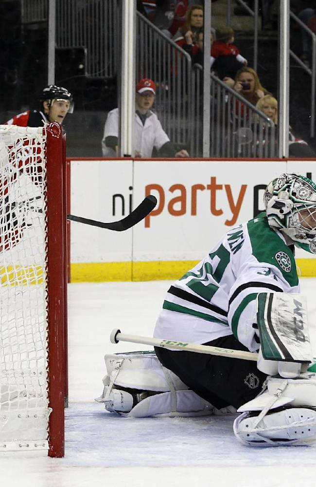 Dallas Stars goalie Kari Lehtonen, of Finland,  gives up a goal to New Jersey Devils right wing Michael Ryder during the second period of an NHL hockey game Thursday, Jan. 9, 2014, in Newark, N.J