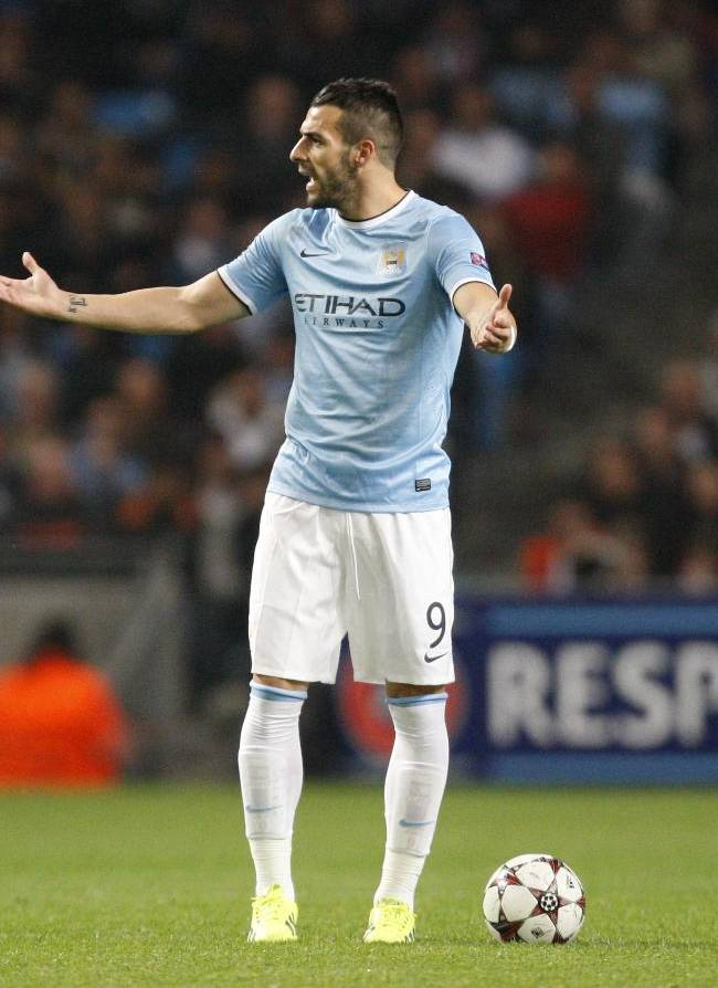 Manchester City's Alvaro Negredo and Sergio Aguero, right, watch celebrating Bayern players during the Champions League group D soccer match between Manchester City and Bayern Munich at the Etihad Stadium in Manchester, England, Wednesday, Oct. 2, 2013