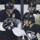 Penguins F Dupuis leaves game on stretcher The Associated Press