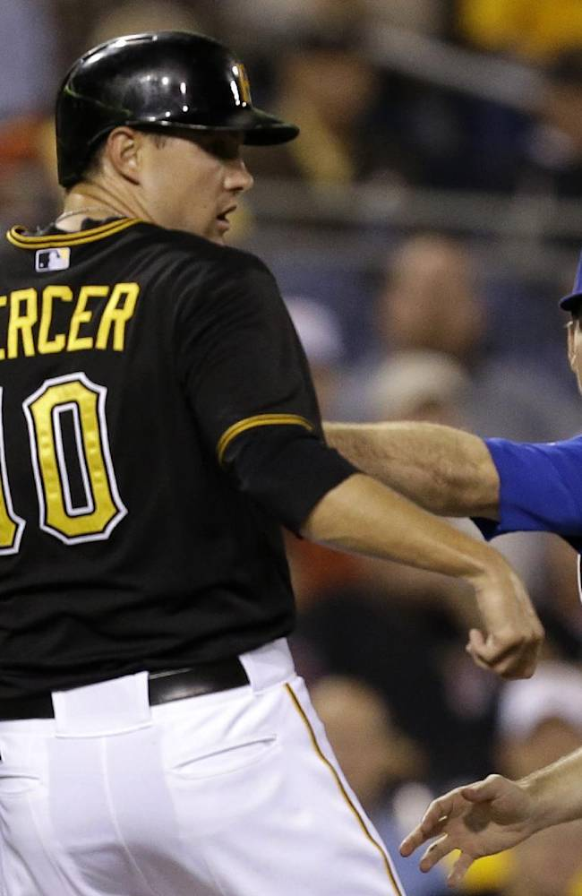 Chicago Cubs third baseman Donnie Murphy, second from right, puts the tag on Pittsburgh Pirates' Jordy Mercer (10) to end a rundown between home and third during the fourth inning of a baseball game in Pittsburgh, Thursday, Sept. 12, 2013