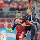 Toronto FC 's Jermain Defoe, left, battles for the ball with Chicago Fire's Jeff Larentowicz during the first half of a soccer game, Saturday, Aug. 23, 2014 in Toronto The Associated Press
