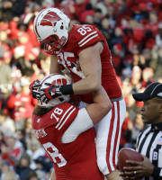 Wisconsin's Brian Wozniak (85) is congratulated by teammate Rob Havenstein (78) after catching a touchdown pass during the first half of an NCAA college football game against Penn State, Saturday, Nov. 30, 2013, in Madison, Wis. (AP Photo/Morry Gash)