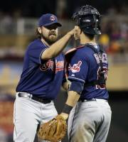 Cleveland Indians pitcher Chris Perez, left, and catcher Yan Gomes celebrate the Indians' 5-2 win over the Minnesota in a baseball game, Tuesday, Aug. 13, 2013 in Minneapolis. Perez picked up the save. (AP Photo/Jim Mone)