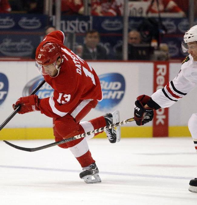 Detroit Red Wings' Pavel Datsyuk (13), of Russia, takes the puck down the ice against Chicago Blackhawks' Duncan Keith (2) in the second period of a preseason NHL hockey game Sunday, Sept. 22, 2013, in Detroit