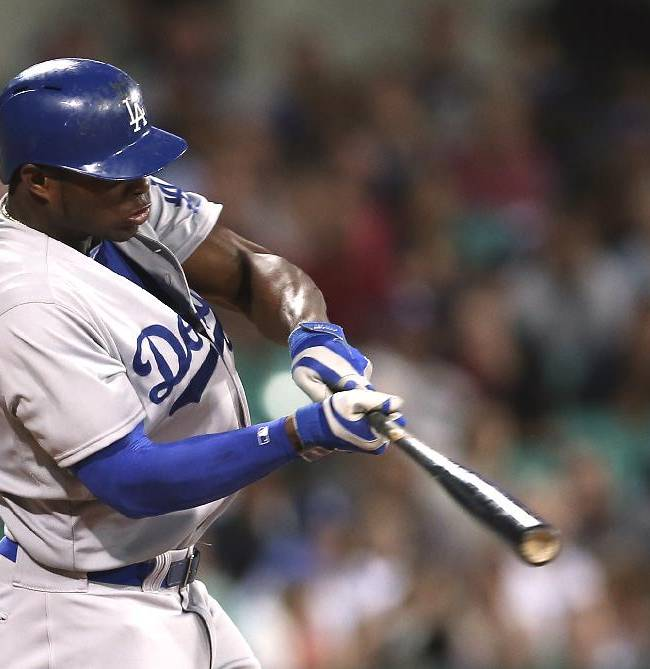 The Los Angeles Dodgers' Yasiel Puig flies out to center in the top of the 9th inning during the Major League Baseball opening game between the Los Angeles Dodgers and Arizona Diamondbacks at the Sydney Cricket ground in Sydney, Saturday, March 22, 2014. The Dodgers won the game 3-1