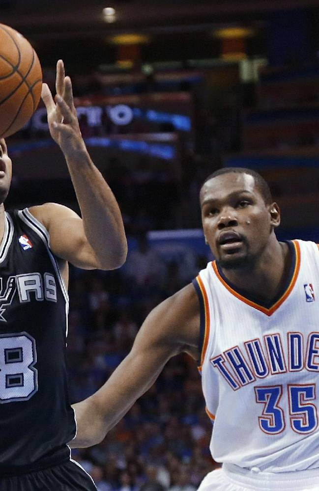 San Antonio Spurs guard Patty Mills (8) drives past Oklahoma City Thunder forward Kevin Durant (35) in the fourth quarter of an NBA basketball game in Oklahoma City, Thursday, April 3, 2014. Oklahoma City won 106-94