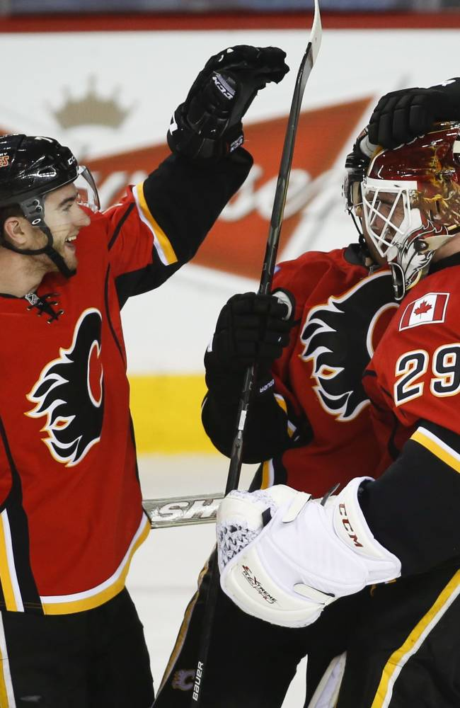 Nystrom scores 4, but Flames beat Preds 5-4 in SO