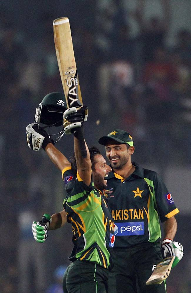 Pakistan's Shahid Afridi, left, celebrates with a teammate after winning the Asia Cup one-day international cricket tournament against India in Dhaka, Bangladesh, Sunday, March 2, 2014. Pakistan won by 1 wicket