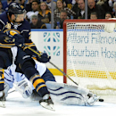 Buffalo Sabres center Zemgus Girgensons (28), of Latvia, scores on Toronto Maple Leafs goaltender James Reimer (34) during the third period of an NHL hockey game Saturday, Nov. 15, 2014, in Buffalo, N.Y. Buffalo won 6-2 The Associated Press