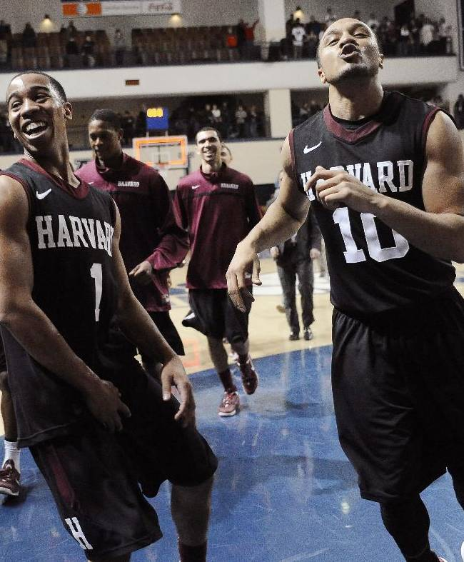 Harvard's Siyani Chambers, left, and Brandyn Curry, right, celebrate their 70-58 win over Yale at the end of an NCAA college basketball game, Friday, March 7, 2014, in New Haven, Conn