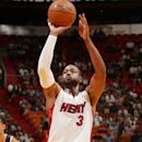 MIAMI, FL - OCTOBER 14: Dwyane Wade #3 of the Miami Heat shoots a free throw against the Atlanta Hawks during the game on October 14, 2014 at AmericaAirlines Arena in Miami, Florida. (Photo by Issac Baldizon/NBAE via Getty Images)