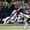 St. Louis Rams wide receiver Kenny Britt catches a 63-yard touchdown pass while being defended by Denver Broncos cornerback Bradley Roby in first quarter action during a game between the St. Louis Rams and the Denver Broncos on Sunday, Nov. 16, 2014, at t