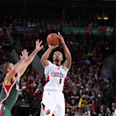 PORTLAND, OR - DECEMBER 17: Damian Lillard #0 of the Portland Trail Blazers shoots the ball against the Milwaukee Bucks during the game on December 17, 2014 at the Moda Center in Portland, Oregon. (Photo by Sam Forencich/NBAE via Getty Images)