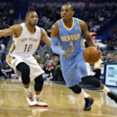 Denver Nuggets shooting guard Randy Foye (4) drives past New Orleans Pelicans shooting guard Eric Gordon (10) in the first half of an NBA basketball game in New Orleans, Sunday, March 9, 2014 The Associated Press