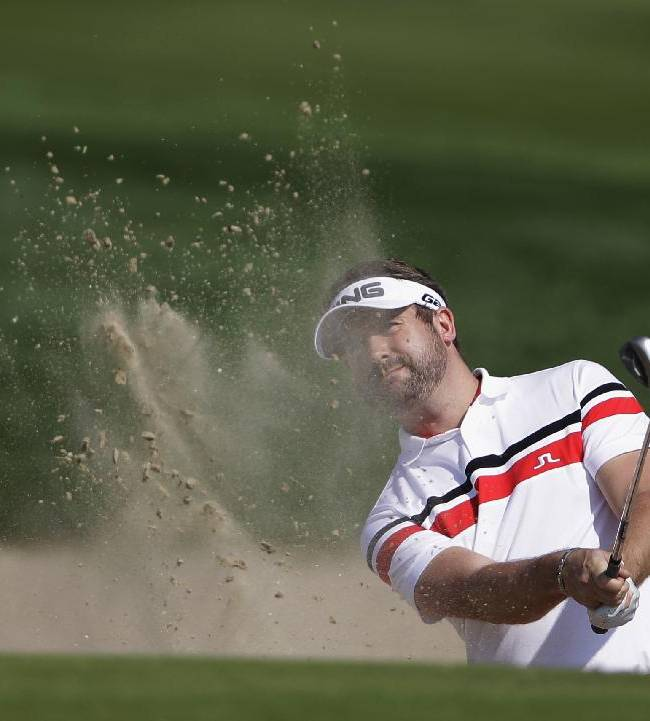 Matthew Baldwin of England plays a bunker shot on the 1st hole during the 2nd round of the Abu Dhabi HSBC Golf Championship in Abu Dhabi, United Arab Emirates, Friday, Jan. 17, 2014