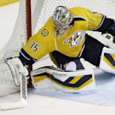 Nashville Predators goalie Pekka Rinne, of Finland, blocks a shot against the Phoenix Coyotes in the third period of a 2-0 shutout win by Rinne in a NHL hockey game on Thursday, April 10, 2014, in Nashville, Tenn The Associated Press