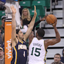 Utah Jazz's Derrick Favors (15) shoots as Indiana Pacers' Luis Scola (4) defends in the first half during an NBA basketball game Wednesday, Dec. 4, 2013, in Salt Lake City The Associated Press