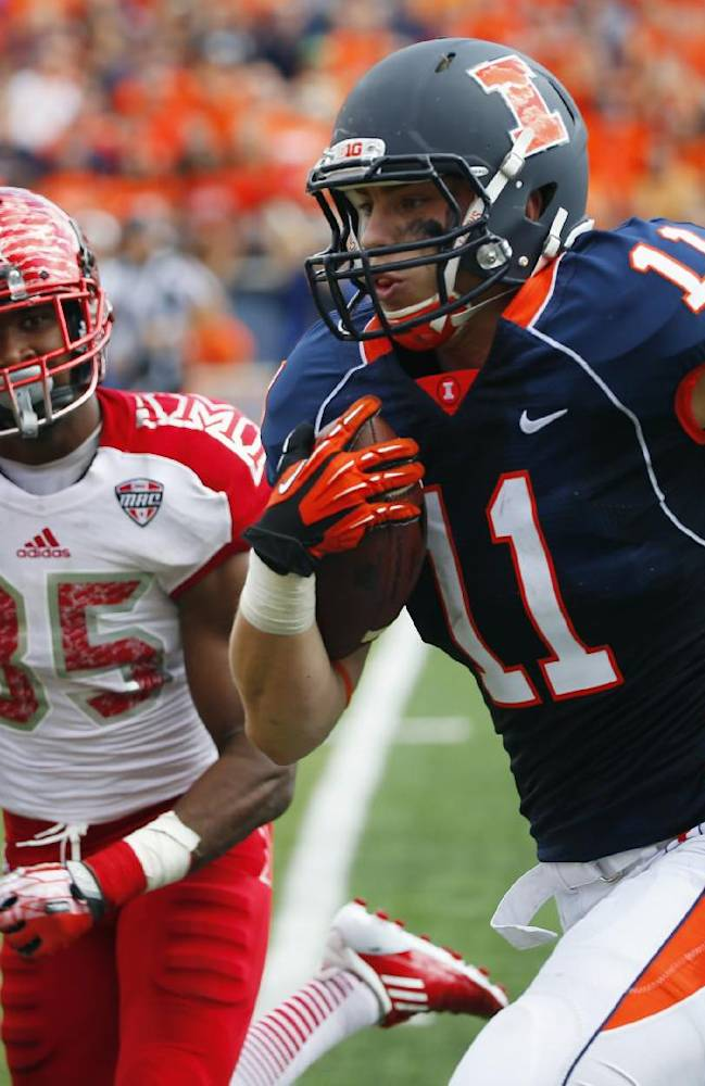 In this Sept. 28, 2013 file photo, Illinois tight end Matt LaCosse (11) runs in for a touchdown past Miami (Ohio) defensive back Brison Burris (35) during an NCAA college football game in Champaign, Ill. The Illini have had strong tight ends, some talented enough to go on to the NFL. But they always seemed to be blockers and pass-route decoys first, receivers second. That's changing this season. Through four games Illinois' tight ends have about as many catches as they had all last season