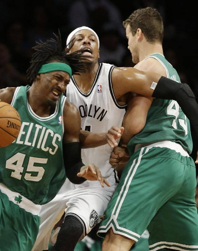 Brooklyn Nets' Paul Pierce (34) fights off a pick by Boston Celtics' Kris Humphries (43) as he defends against Boston's Gerald Wallace (45) during the first half of a preseason NBA basketball game Tuesday, Oct. 15, 2013, in New York