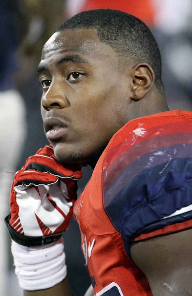 In this Nov. 9, 2013 file photo, Arizona's Ka'Deem Carey watches from the bench during a game against UCLA, in Tucson, Ariz. Carey will forgo his final season of college eligibility and enter the NFL draft. Carey revealed his decision in an announcement issued by the university
