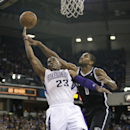 Sacramento Kings guard Marcus Thornton, left, drives to the basket against Brooklyn Nets guard Alan Anderson during the fourth quarter of an NBA basketball game in Sacramento, Calif., Wednesday, Nov. 13, 2013. The Kings won 107-86 The Associated Press