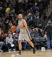 SAN ANTONIO, TX - March 2: Tony Parker #9 of the San Antonio Spurs handles the ball during a game against the Dallas Mavericks at the AT&T Center on March 2, 2014 in San Antonio, Texas