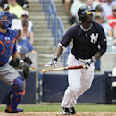 New York Mets catcher Travis d'Arnaud, left, and New York Yankees' Didi Gregorius watch Gregorius's third-inning, ground rule double in an exhibition baseball game in Tampa, Fla., Wednesday, March 25, 2015. (AP Photo/Kathy Willens)