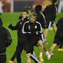 Real Madrid's Luka Modric, center, trains with teammates at Anfield Stadium in Liverpool, England, Tuesday, Oct. 21, 2014. Real Madrid will play Liverpool in a Champion's League Group B soccer match on Wednesday