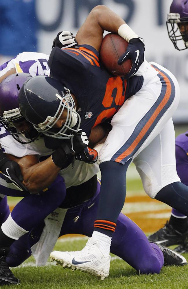 Chicago Bears running back Matt Forte (22) is tackled by Minnesota Vikings safety Jamarca Sanford during the first half of an NFL football game on Sunday, Sept. 15, 2013, in Chicago