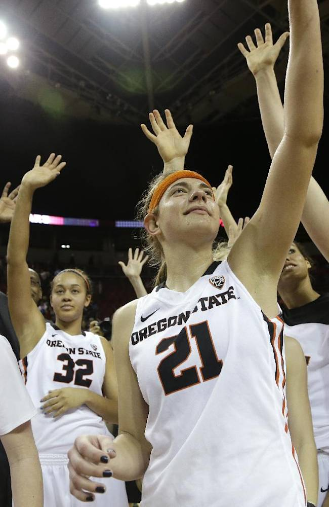 Oregon State's Ali Gibson (14), Deven Hunter (32), Sydney Wiese (21) and Ruth Hamblin (44) wave with teammates to fans after beating Washington State in an NCAA college basketball game in the Pac-12 women's tournament  Saturday, March 8, 2014, in Seattle. Oregon State won 70-60