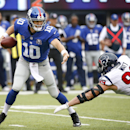 New York Giants quarterback Eli Manning (10) tries to avoid Houston Texans defensive end J.J. Watt (99) in the first quarter of an NFL football game, Sunday, Sept. 21, 2014, in East Rutherford, N.J The Associated Press