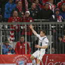 Manchester City's James Milner celebrates his side's leading goal during the Champions League group D soccer match between FC Bayern Munich and Manchester City, in Munich, southern Germany, Tuesday, Dec. 10, 2013
