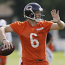Chicago Bears quarterback Jay Cutler (6) looks to a pass during team's NFL football training camp at Olivet Nazarene University on Friday, July 25, 2014., in Bourbonnais, Ill The Associated Press