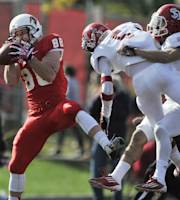 Illinois State wide receiver Scott Kuehn (88) catches a touchdown pass against South Dakota's Tevin Foster (5) and Devin Taverna (2) during the first half of an NCAA college football game in Normal, Ill., Saturday, Oct. 26, 2013. (AP Photo/Paul Beaty)