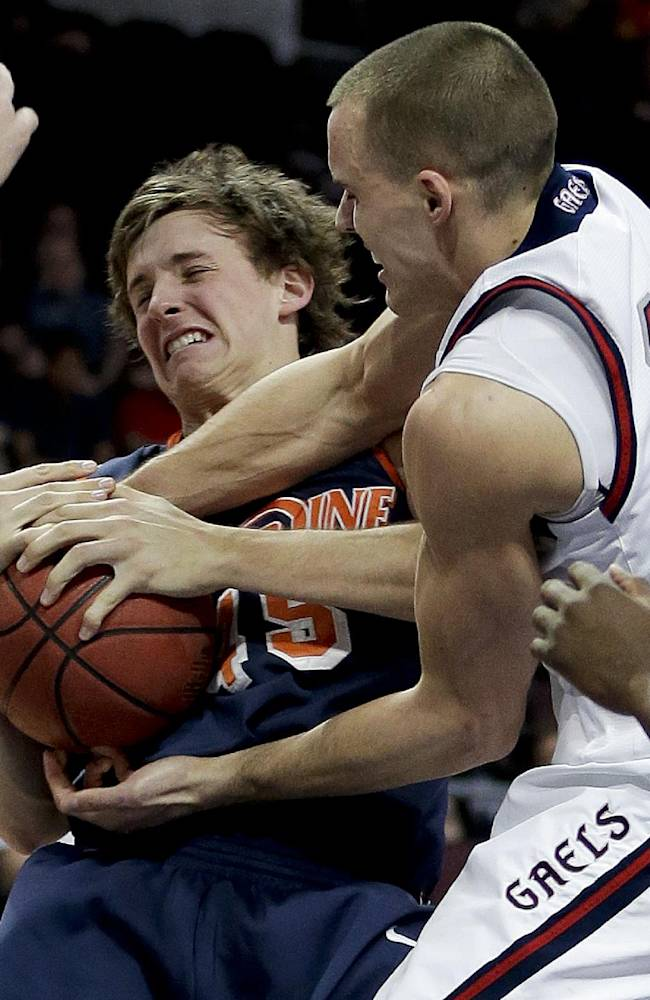 Pepperdine's Jett Raines, left, fights for a rebound against Saint Mary's Beau Levesque in the second half of a quarterfinal West Coast Conference NCAA college basketball tournament game, Saturday, March 8, 2014, in Las Vegas